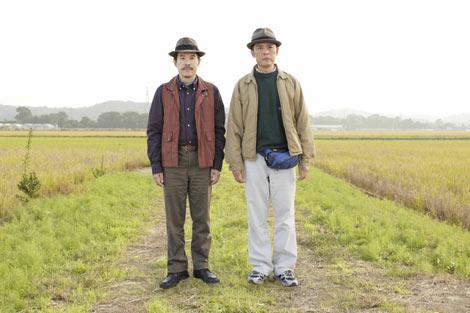 イラストの元になった映画『あぜみち道のダンディ』のメインビジュアル  (C)2011『あぜ道のダンディ』製作委員会