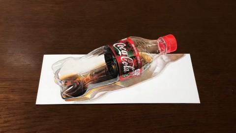 立体のコーラにしか見えないが、一枚の紙に描いた絵だ