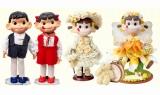 会場で展示される(左から)「電動ペコちゃんポコちゃん人形」、「YEAR'S ペコちゃんドール」 (C)FUJIYA CO.,LTD