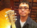 プレミアムギターをチャリティーオークションに出品する奥田民生