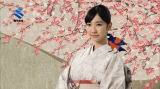 伝統的工芸品の大島紬を着る柏木