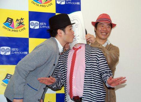 会見で夏川純似のみほさんの似顔絵と熱烈なチューをするすぎ。