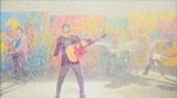ずぶ濡れで歌唱、演奏するflumpool