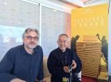 上映後、取材に応じるマイケル監督と鈴木プロデューサー