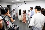 囲み取材を受ける模様=日本ハムVSヤクルト戦のファーストピッチセレモニー(C)2016「貞子vs伽椰子」製作委員会