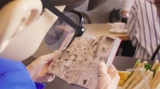 CMでコナンくんが愛読しているのは…(C)青山剛昌/小学館