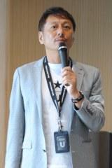 事業戦略を説明する宇野康秀代表取締役社長CEO