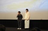 アニメーション映画『天気の子』世界最速上映後に急きょ舞台あいさつに登壇した新海誠監督(左)と音楽監督のRADWIMPS・野田洋次郎