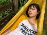 渡邉美穂=日向坂46の1st写真集『立ち漕ぎ』オフショット(写真は公式ツイッターより)