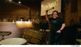 超実写版『ライオン・キング』でドラムを叩くジョン・ファヴロー監督 (C)2019 Disney
