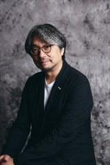 「77億人えがおプロジェクト」発案者の一人、放送作家の小山薫堂氏